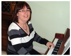 Piano Teacher playing piano