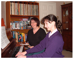 Ceinwen at piano